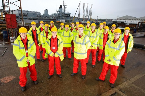 Cammell Laird apprentices with the RFA Fort Victoria in the background