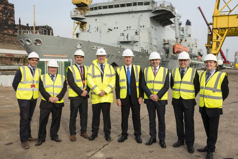 Sir Michael Fallon centre with Cammell Laird team John Syvret CEO to his left Linton Roberts managing director to his right