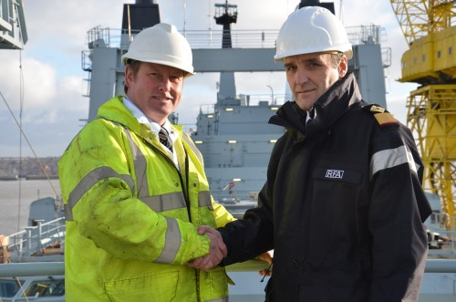 Cammell Laird's Spencer Atkinson and the RFA's Commodore Ian Schumaker at the completion of the a refit to the RFA Fort Victoria in 2014.